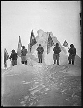 Photograph of the Robert Peary Sledge Party Posing with Flags at what was assumed to be the North Pole