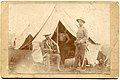 Photograph of three officers in the First North Carolina Regiment in the U.S. Volunteers, pictured at a U.S. Army tent in an unidentified military camp during the Spanish-American War. Pictured are (28772420352).jpg