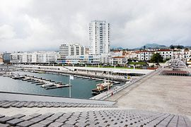 The urbanized coastal limit of Ponta Delgada at São Sebastião, including the commercial mall and business quarter, as seen from the Portas do Mar