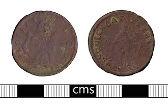 St Patrick halfpenny - St Patrick token, dated to between 1658 and 1670. The coin is heavily worn but the legends FLOREAT REX and QUIESCAT PLEBS are legible.
