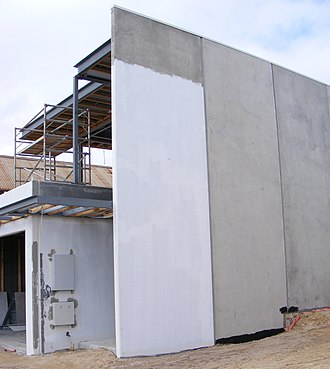 Prefabrication - A house being built with prefabricated concrete panels.