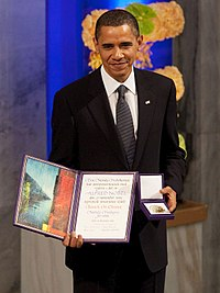 President Barack Obama with the Nobel Prize medal and diploma.jpg