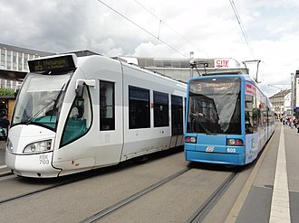 Tram-train - Kassel RegioTram dual voltage DC/AC Alstom RegioCitadis next to a KVG Bombardier Flexity Classic tram at Königsplatz