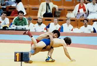 Wrestling at the 1980 Summer Olympics - Zhaksylyk Ushkempirov (USSR, in red) and Pavel Hristov (Bulgaria, in blue) at the 1980 Summer Olympics. RIAN photo.