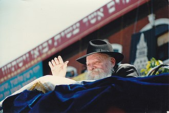 Menachem Mendel Schneerson - Waving to children at a Lag BaOmer parade.