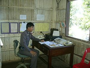 Police radio - A radio operator of the Royal Thai Police.