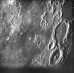 Ranger 7 - First image of the Moon taken by a U.S. spacecraft. The large crater at center right is Alphonsus