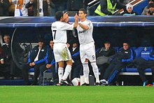 Raúl being substituted by Cristiano Ronaldo during a match in November 2009.  Ronaldo would wear the  7 jersey at Real Madrid after Raúl s departure in  2010. 738cbd70a