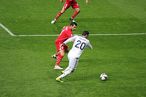 Gonzalo Higuaín - Higuaín attempting to dribble past Emir Spahić of Sevilla in February 2013