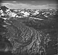 Red Glacier, terminus of mountain glacier mostly covered in rocks, and icefall on the upper portions, August 23, 1979 (GLACIERS 6739).jpg