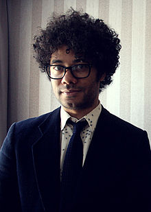 Ayoade facing the camera