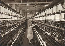 Ring spinning machine in the 1920s.jpg