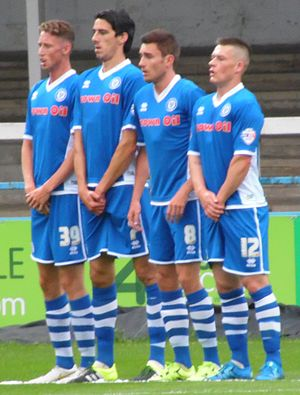 Rochdale A.F.C. - Rochdale players Joe Bunney, Peter Vincenti, Matty Lund and Donal McDermott line-up in a wall against Blackburn Rovers in July 2015