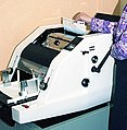 Roneo-type machine being used in an office.jpg