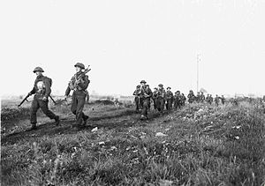 Royal Winnipeg Rifles - Troops of the Royal Winnipeg Rifles near Ifs, France, 25 July 1944.