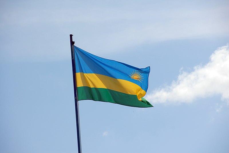 Rwanda flag against light blue sky