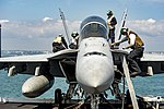 Sailors conduct routine maintenance on a F-A-18F Super Hornet. (36233021180).jpg