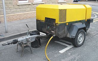 Abrasive blasting - Diesel powered compressor used as an air supply for sandblasting