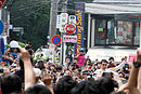 Sebastien Buemi and croud 2011 Red Bull Energy for Japan.jpg
