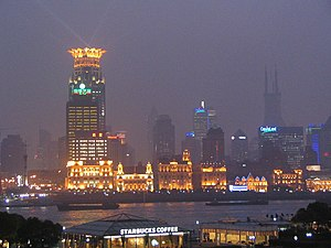 Geography of Shanghai - The Bund and the skyline behind it during a rainy evening
