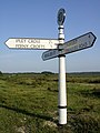 Signpost at the junction southeast of Bealieu Road station, New Forest - geograph.org.uk - 28338.jpg