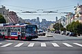 Silver-and-red Muni ETI 14TrSF turning at north end of route 22-Fillmore (2014).jpg