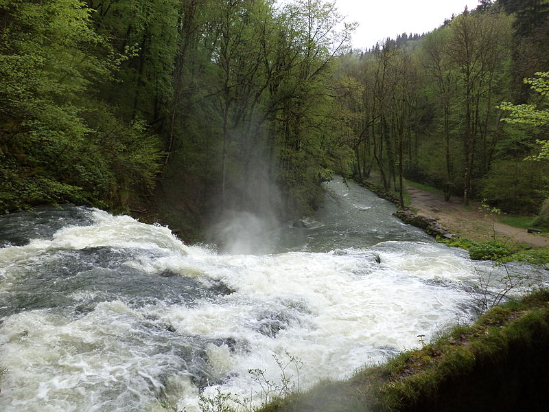 The source of the river Lison from the cave seen, in the French Jura