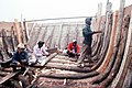 Sri Lankan laborers build a dhow, the primary boat used by fishermen and merchants in the Persian Gulf area - DPLA - 7c1de806546957c1f8ee3a7acb2e9021.jpeg