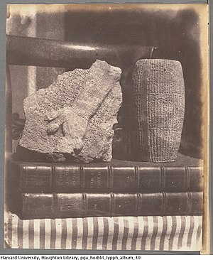 Thomas Phillipps - Still life with ancient Babylonian artifacts on books, salted paper print, 1853, by Amelia Elizabeth Guppy