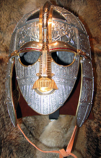 "Battle of Strasbourg - Reconstruction of the 7th-century parade helmet found in the Sutton Hoo Anglo-Saxon royal burial site. Based on a late Roman design known as a 'ridge-helmet', this type of helmet was commonly used by the Roman cavalry of the 4th to 6th centuries. This expensive, highly decorative version, designed for royalty, is likely similar to Chnodomar's ""flashing helmet"" described by Ammianus (XVI.12.24). Note the fake eyebrows, moustache and lips attached to the face-guard"