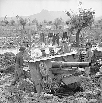 1st Renfrew and Dumbarton Artillery Volunteers - A 25-pdr in a waterlogged position in Italy, October 1944.