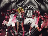 "Both the performances of ""Bad Romance"" on the original (left) and the revamped (right) shows featured a giant gyroscope."