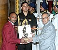 The President, Shri Pranab Mukherjee presenting the Arjuna Award for the year-2015 to Shri S. Sathish Kumar for Weightlifting, in a glittering ceremony, at Rashtrapati Bhavan, in New Delhi on August 29, 2015.jpg