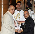 The President, Shri Pranab Mukherjee presenting the Padma Shri Award to Dr. Ramakant Krishnaji Deshpande, at a Civil Investiture Ceremony, at Rashtrapati Bhavan, in New Delhi on March 31, 2014.jpg