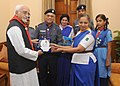 The Vice President, Shri Mohd. Hamid Ansari being presented a memento by the Scouts and Guides, on the occasion of Bharat Scouts & Guides Flag Day, in New Delhi on November 10, 2014.jpg
