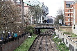 The West London Line passing through Fulham at the site of the former station