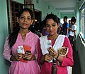 The young voters showing their voter identity card after casting their votes, at a polling booth, during the 5th Phase of General Elections-2014, at Darjeeling, West Bengal on April 17, 2014.jpg
