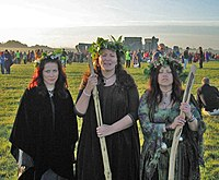 Three druidesses at Stonehenge on the morning ...