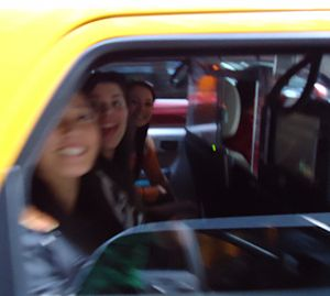 Motion blur - A taxicab starting to drive off blurred the faces in the image.