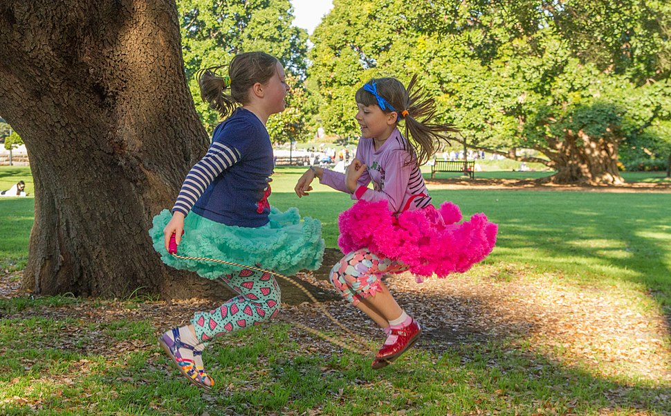Two girls playing skipping rope