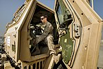 U.S. Air Force Staff Sgt. William Voorheis, an aerial porter with the 455th Expeditionary Aerial Port Squadron, starts up a light medium tactical vehicle during a joint inspection at Bagram Airfield in Parwan 131002-F-YL744-024.jpg