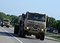 U.S. Army M1088 tractor trucks operated by Soldiers with the 565th Quartermaster Company transport simulated medical supplies to the Indiana National Guard Armory in Scottsburg, Ind 120802-F-HS649-040.jpg