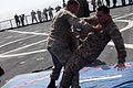U.S. Marines with Security Cooperation Task Force Africa Partnership Station (APS) 2012 practice Marine Corps Martial Arts Program techniques on the flight deck of the amphibious dock landing ship USS Fort 120804-M-JU449-161.jpg