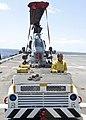 U.S. Navy Aviation Boatswain's Mate Handling 3rd Class Hannah Marihugh tows a Marine Corps AH-1N Cobra helicopter on the flight deck of amphibious transport dock ship USS New York (LPD 21) April 13, 2012 120413-N-XK513-023.jpg