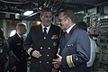U.S. Navy Cmdr. Sean Maxwell, left foreground, and German navy Cmdr. Stephan Jutten, both attaches to Israel, speak during a reception on the bridge of the guided missile destroyer USS Stout (DDG 55) 140120-N-UD469-813.jpg
