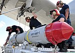 U.S. Navy aviation ordnancemen assigned to Patrol Squadron (VP) 47 prepare to load an AGM-84D Harpoon missile onto the wing of a P-3C Orion.jpg