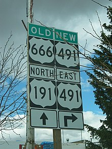 Sign assembly with 4 signs:Top left – Old US 666, Top right – New US 491, Bottom Left – North US 191 straight ahead, Bottom Right – US 491 Right turn