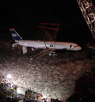 US Airways Flight 1549 - The plane being recovered from the river during the night of January 17