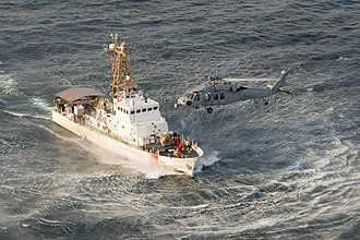 Island-class patrol boat - Image: USCGC Maui (WPB 1304) with MH 60S of HSC 26 off Bahrain in December 2014