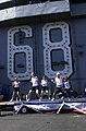 US Navy 030501-N-2143T-001 Sailors assigned to USS Nimitz (CVN 68) and Carrier Air Wing Eleven (CVW-11) participate in cardio-kickboxing during a steel beach picnic held on the flight deck of the Nimitz.jpg